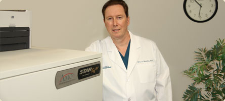 dr boothe next to the visx star s4 lasik laser